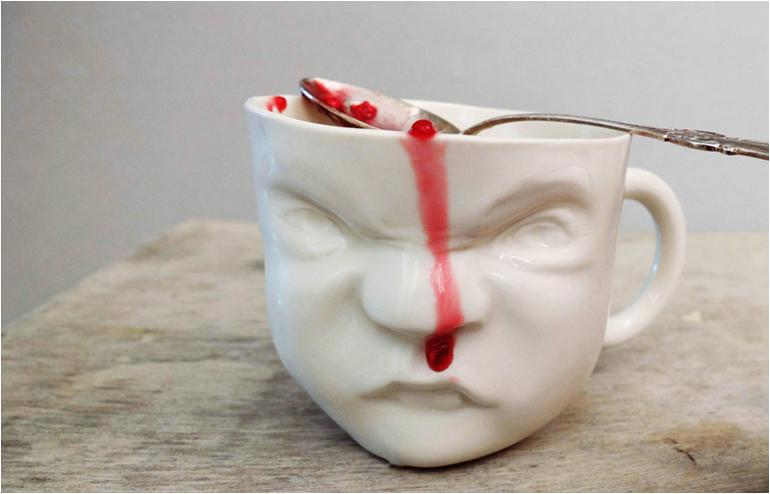 Dima Gurevich's grumpy mugs. // via: Design Break