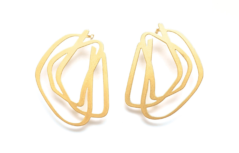 inSync's The Line Collection. Accessories by jewelry designer, Iris Saar Isaacs. // via: Design Break